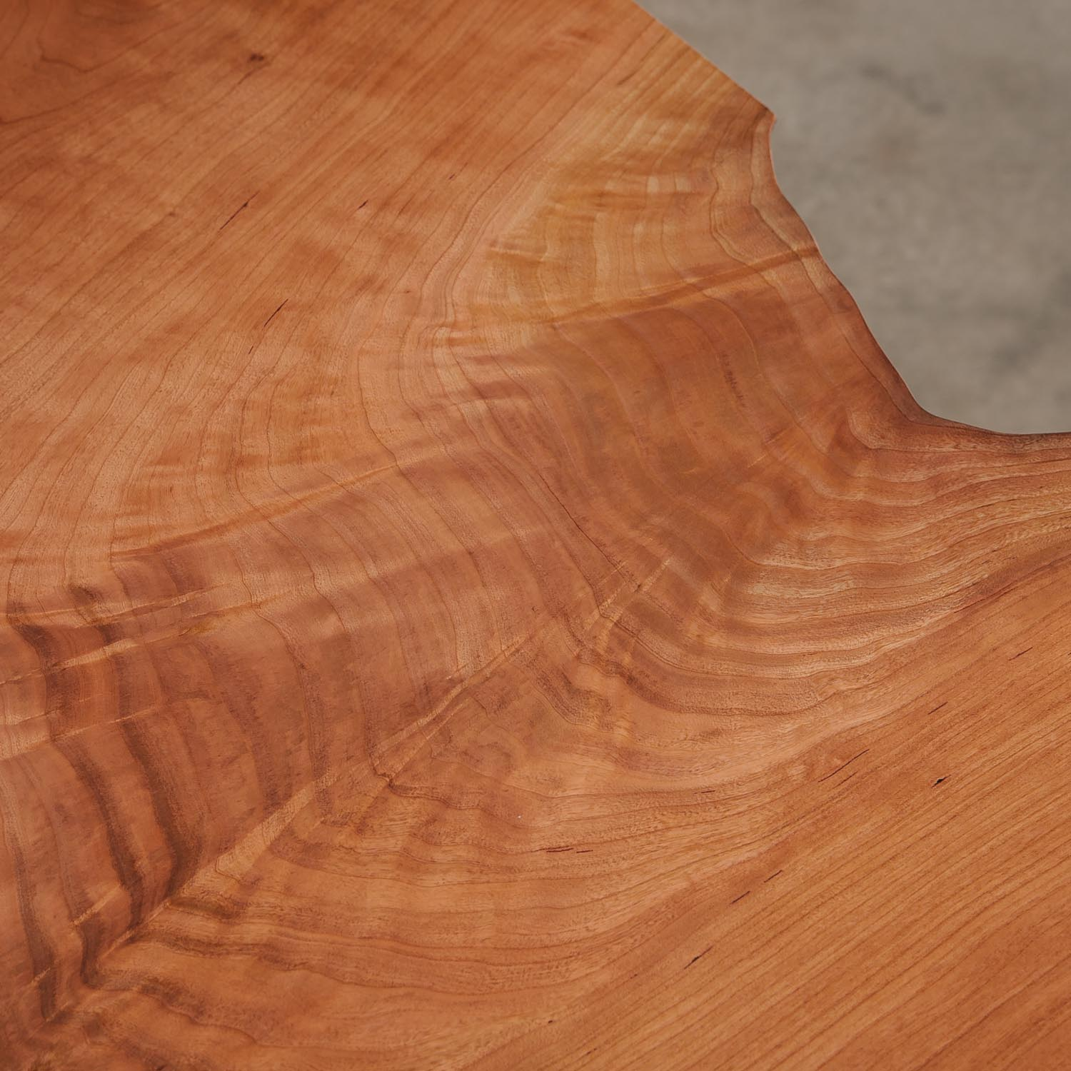 Figured cherry grain with natural tree rings on table