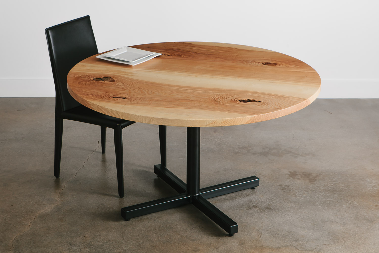 Round live edge ash table for coworking space