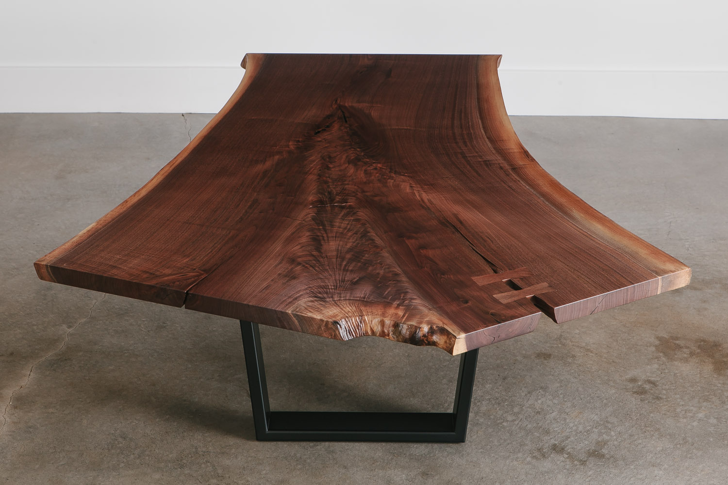 Modern live edge walnut tree coffee table with trapezoid base