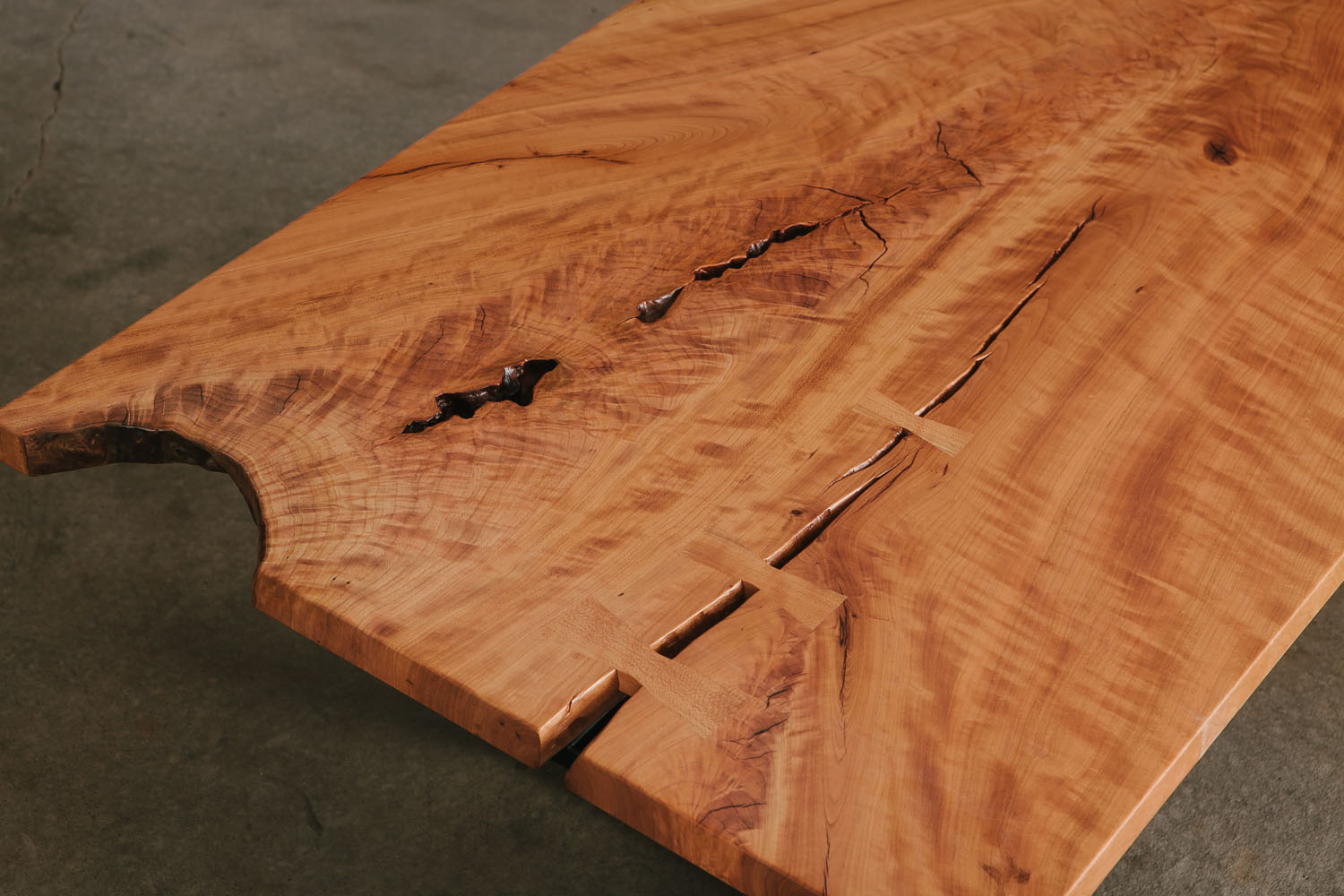 Live edge cherry slab with figured grain and natural tree elements
