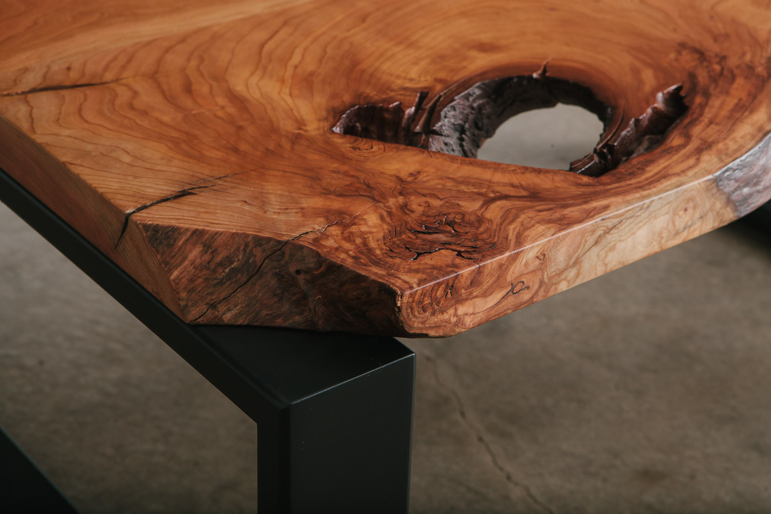 Unique cherry slab void in coffee table