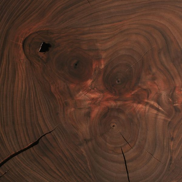 Walnut wood grain detail on luxury table