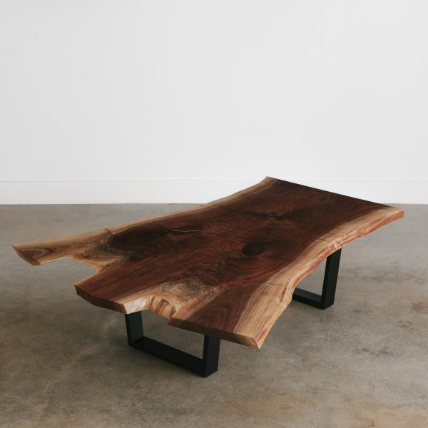Live edge walnut coffee table with trapezoid legs