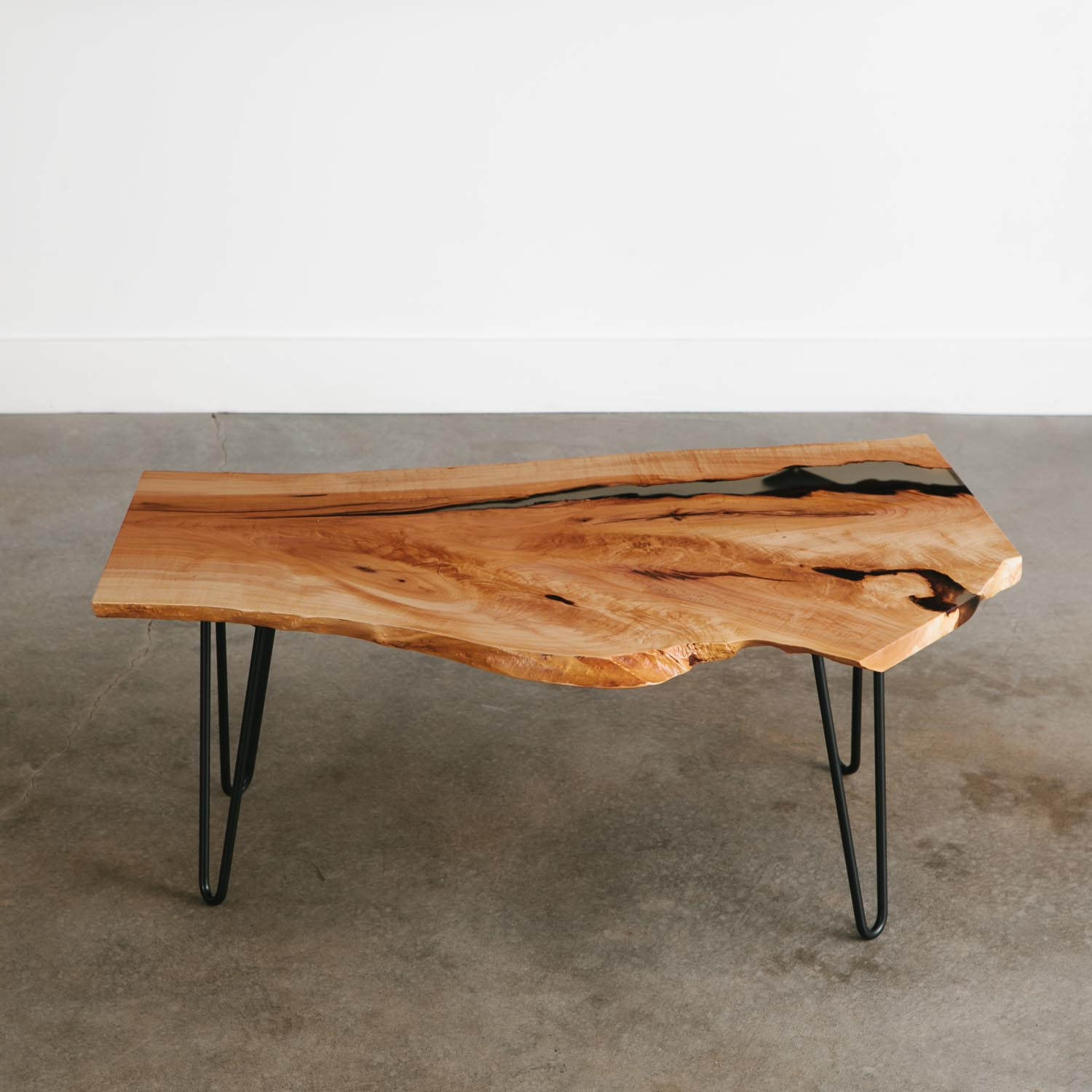 Modern live edge coffee table with hairpin legs and clear resin