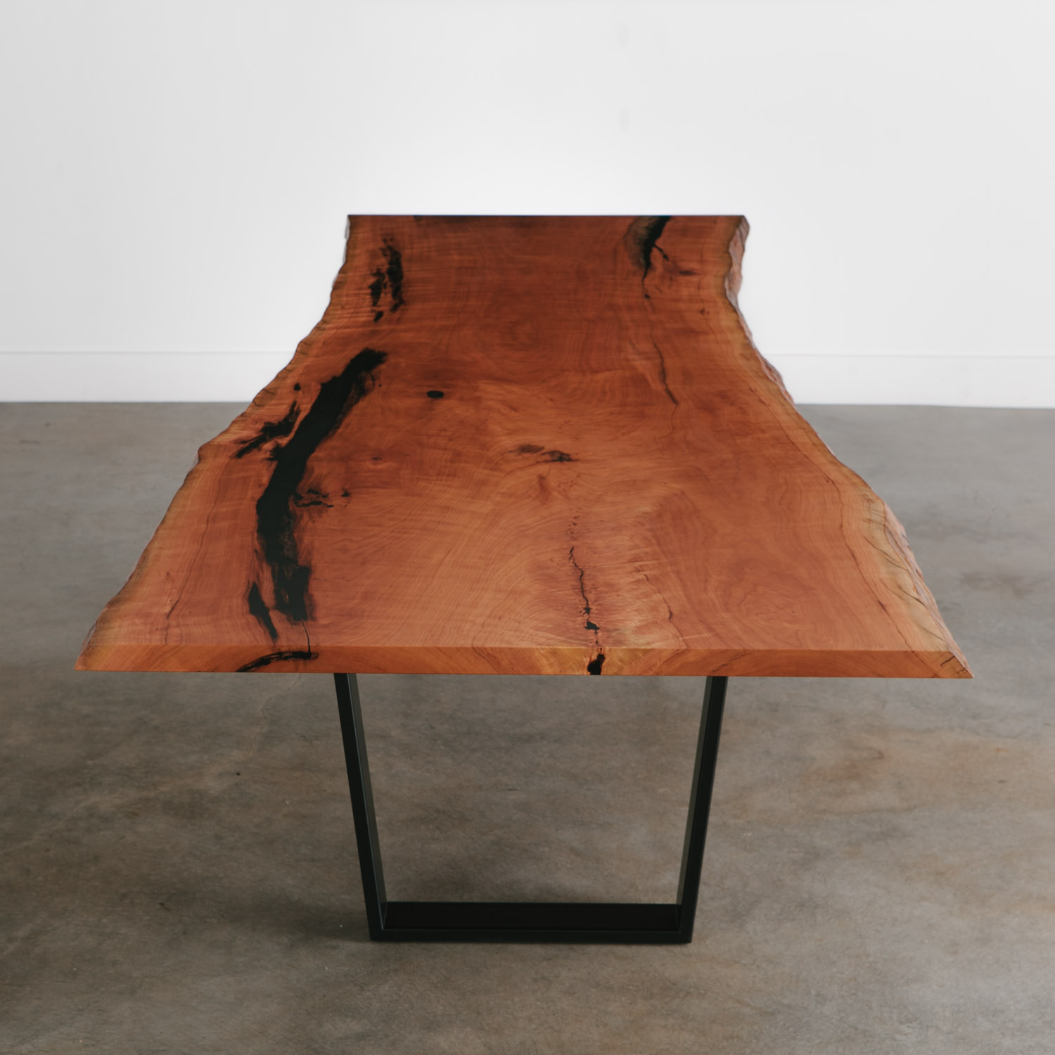Modern live edge cherry table with steel legs