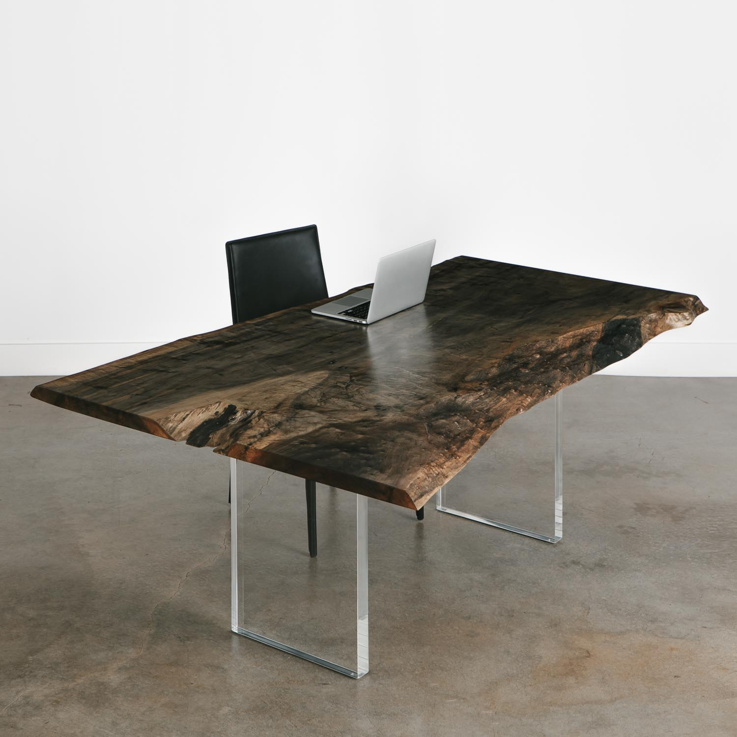 Contemporary natural live edge table with acrylic legs