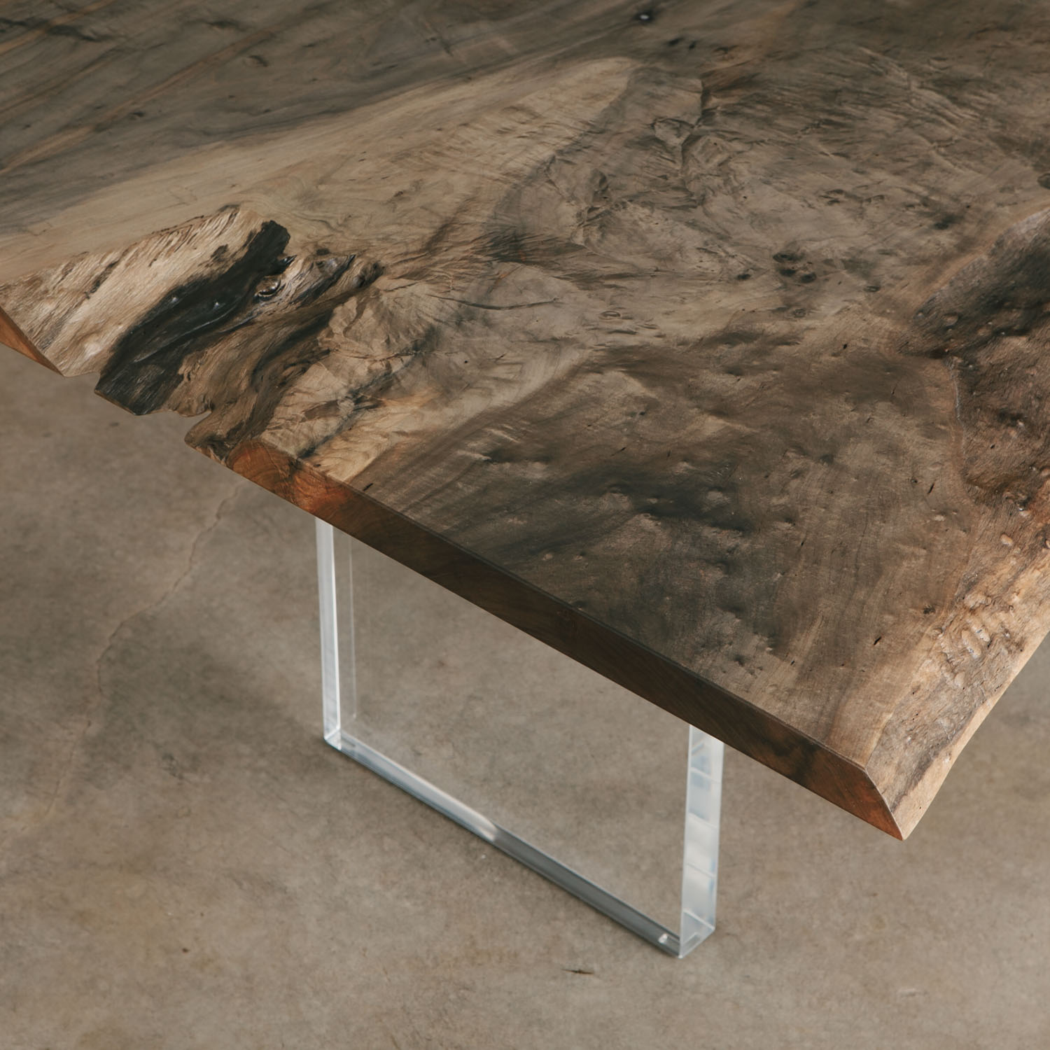 Modern dark wood dining table lucite