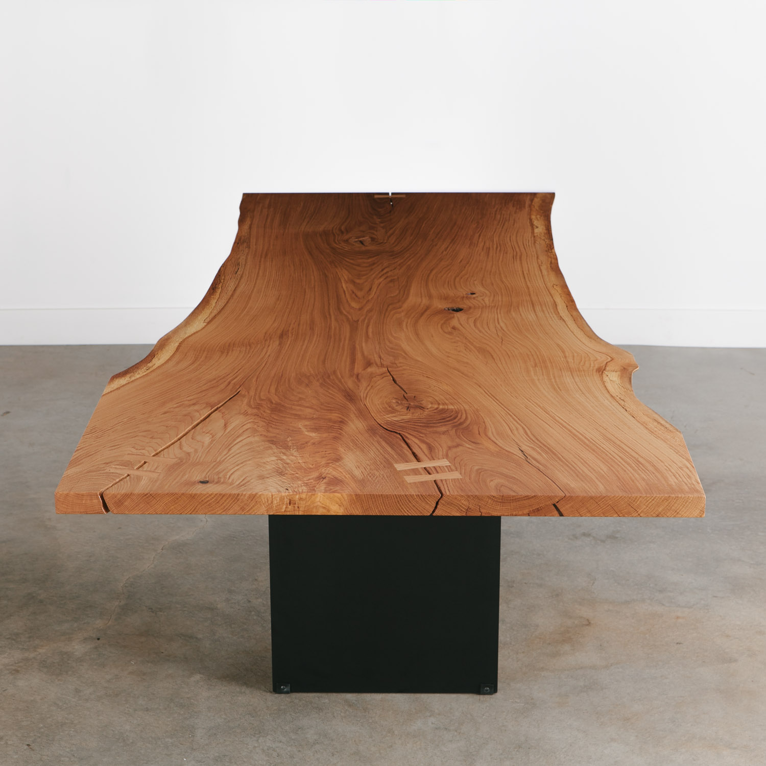Trendy modern slab live edge dining table with black base