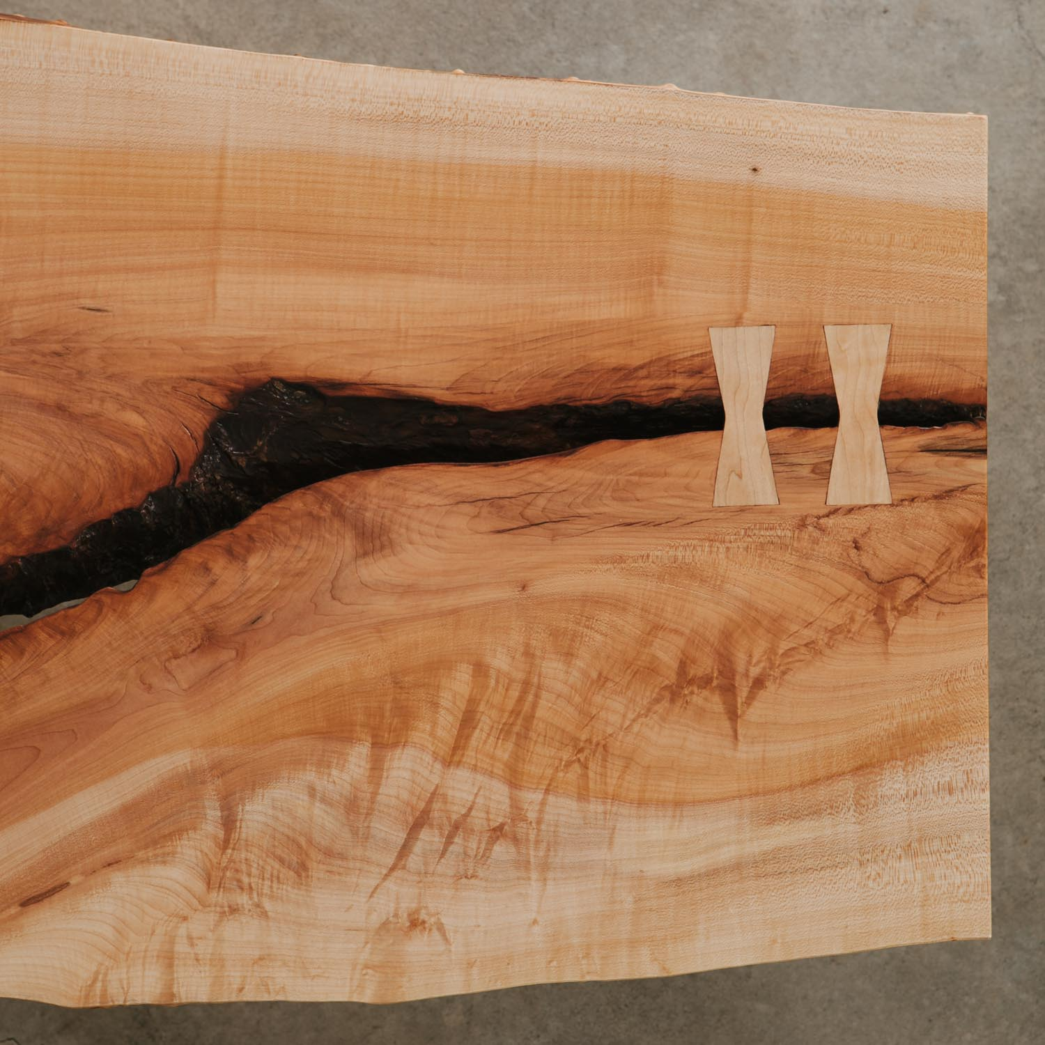 Maple slab butterfly joints with natural wood characteristics