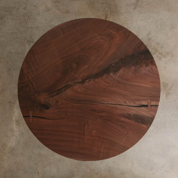Modern round walnut dining table