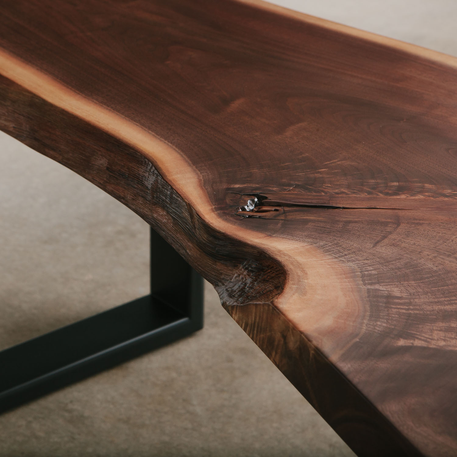 Walnut slab bench with natural tree knot