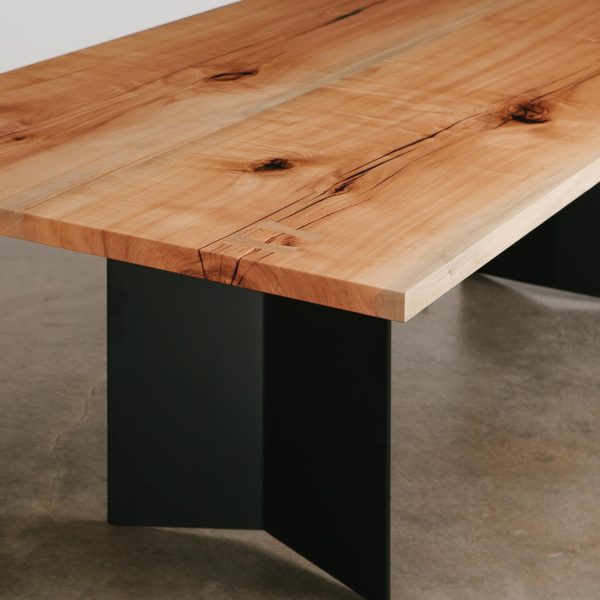 Trendy live edge table with steel base