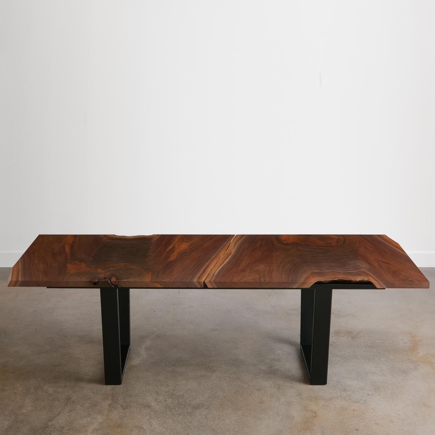 Live edge salvaged walnut table with steel legs