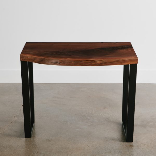 Trendy walnut live edge slab turned into a desk