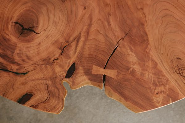 Contemporary live edge cherry slab table with natural tree detail