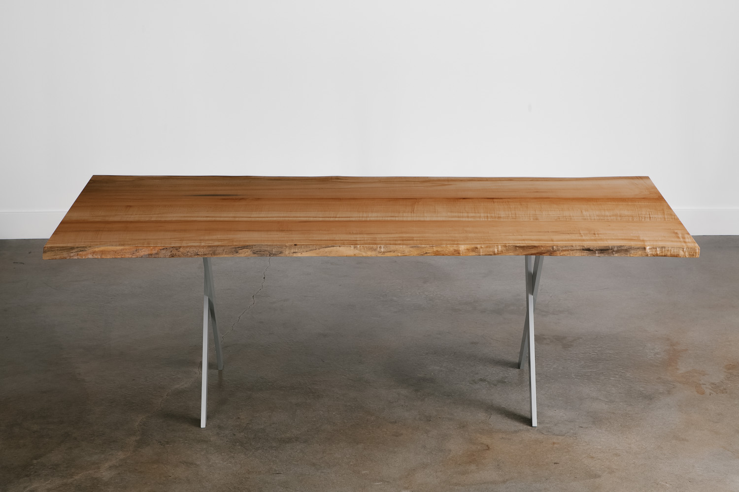 Dining table with live tree edge and silver legs