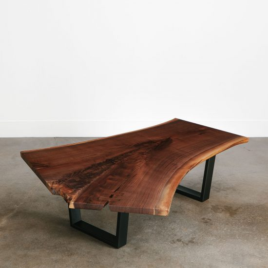 Walnut single slab live edge coffee table with black steel base