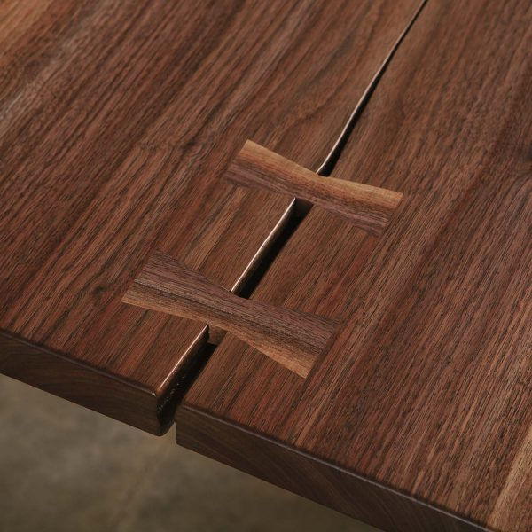 Luxury dining room table with walnut hand cut butterfly joint