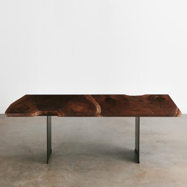 Modern natural edge walnut table with contemporary steel plate legs