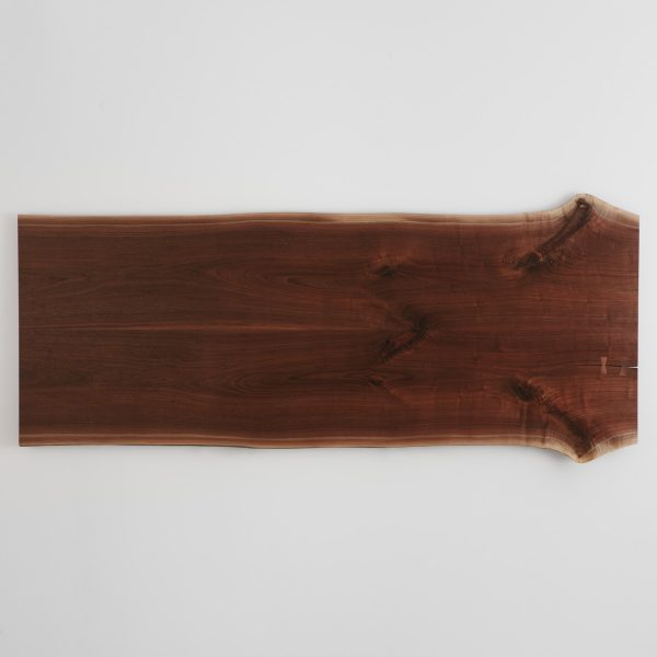 Bookmatched walnut live edge slab turned into trendy table