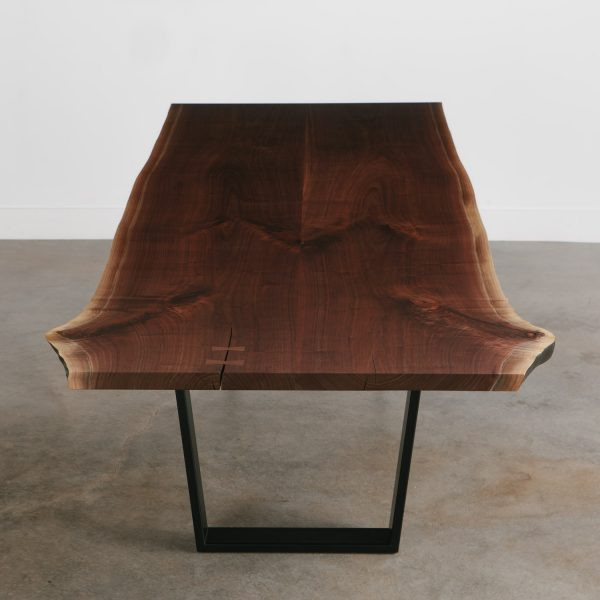 Bookmatched walnut slabs live edge modern dining room table
