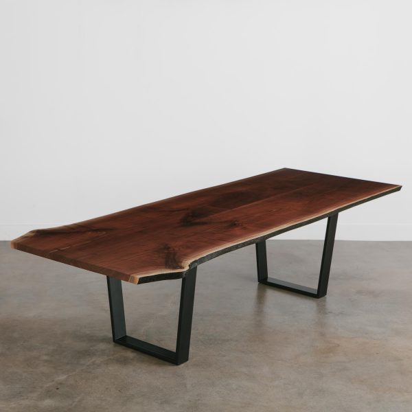 Live edge walnut conference table with black legs