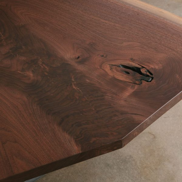 Figured walnut grain detail with natural tree knot