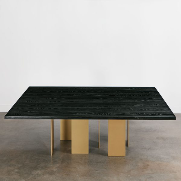 Black dining room table with gold brass base