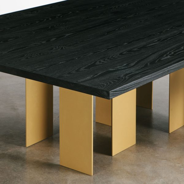 Black dining room table with handmade brass legs