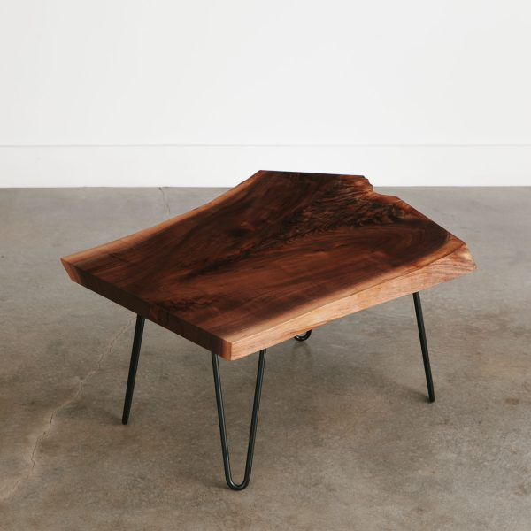 Modern live edge walnut coffee table with skinny black base for apartment