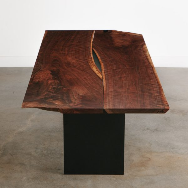 Modern live edge walnut dining table with clear resin and black steel base