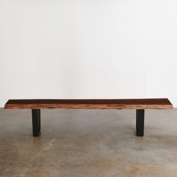 Long modern walnut bench seats four at Elko Hardwoods furniture store showroom