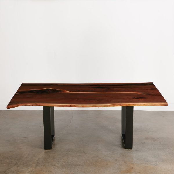 Contemporary walnut dining room table with black steel base