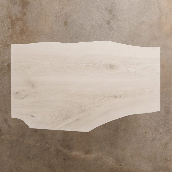 Whitewashed ash slab coffee table at Elko Hardwoods furniture store