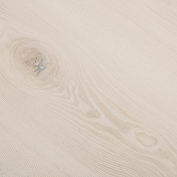 Whitewashed wood grain detail at Elko Hardwoods furniture store Chicago