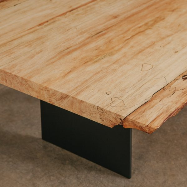 Live edge slab coffee table with steel base