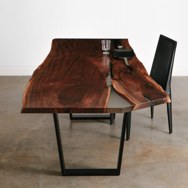 Handmade live edge walnut dining table with clear resin