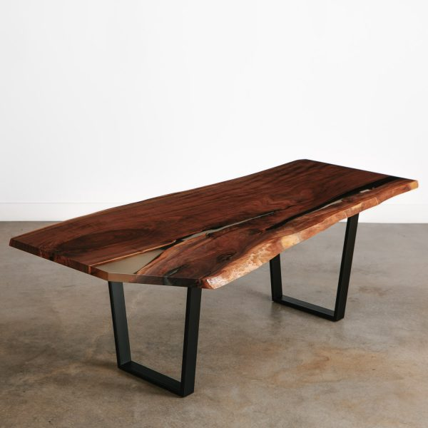 Walnut single slab dining table with beautiful character and resin filled cracks
