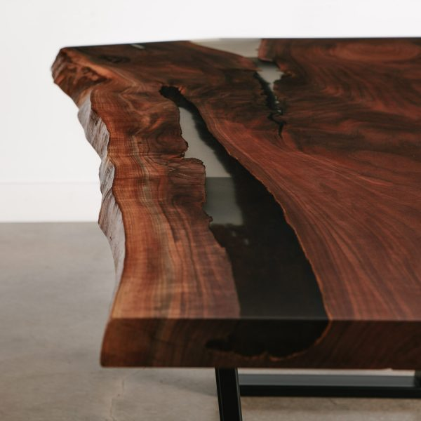 Detail of live edge walnut slab with clear resin filled cracks