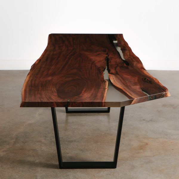 Live edge walnut dining table with clear resin and steel trapezoid base