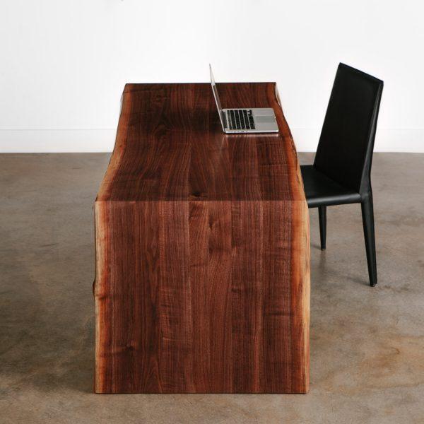 Custom live edge walnut desk with folded waterfall base