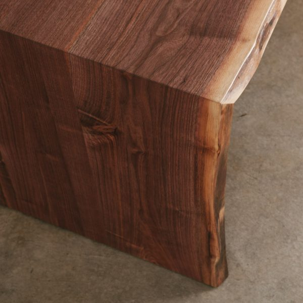 Detail of live edge walnut desk with handmade waterfall joint