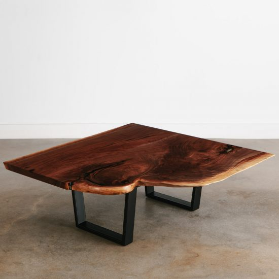 Curved live edge walnut coffee table with black steel legs at Elko Hardwoods furniture store Chicago