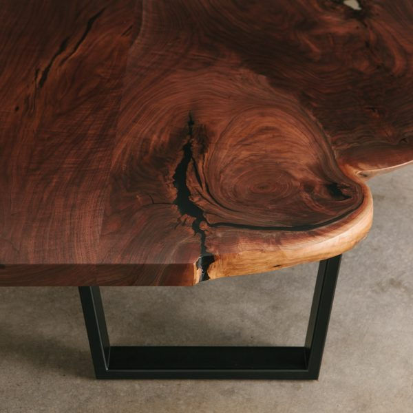 Luxury walnut slab coffee table salvaged wood grain at Elko Hardwoods furniture store Chicago