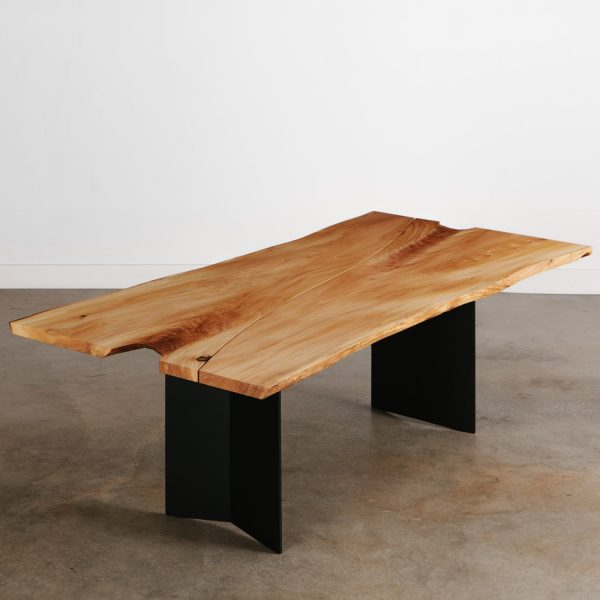Modern live edge elm dining room table with black steel legs at Elko Hardwoods furniture store Chicago