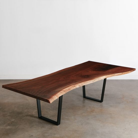 Single slab walnut live edge conference table with black steel legs