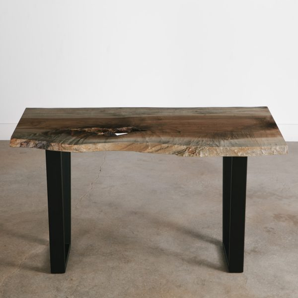 Live edge oxidized maple table with natural tree knot at Elko Hardwoods furniture store Chicago