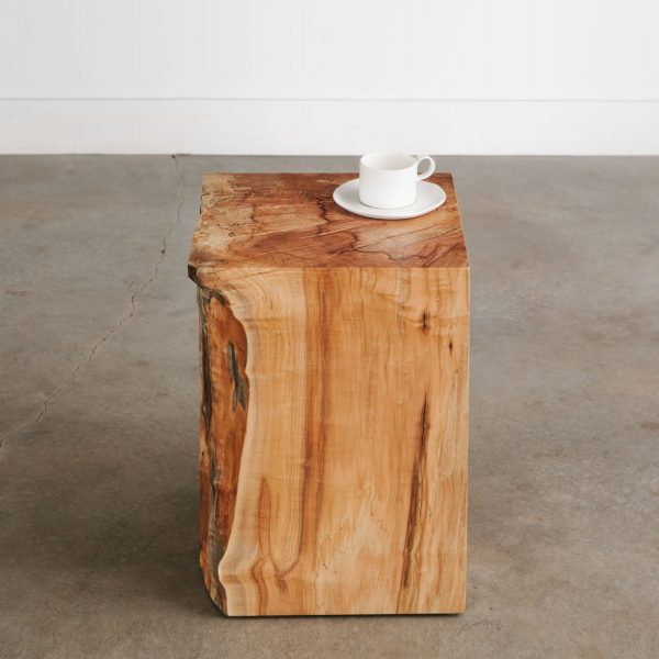 Trendy live edge hardwood side table with natural tree character at Elko Hardwoods furniture store in Chicago