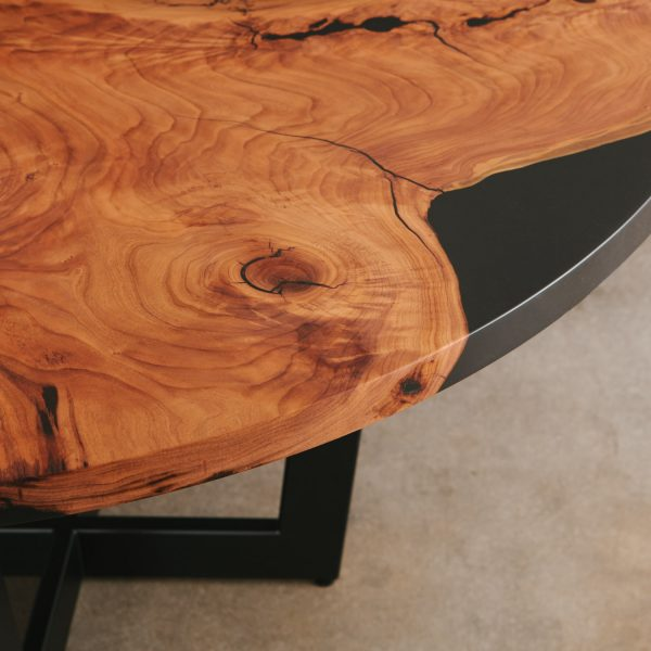 Modern live edge round cherry table with black steel base at Elko Hardwoods Chicago