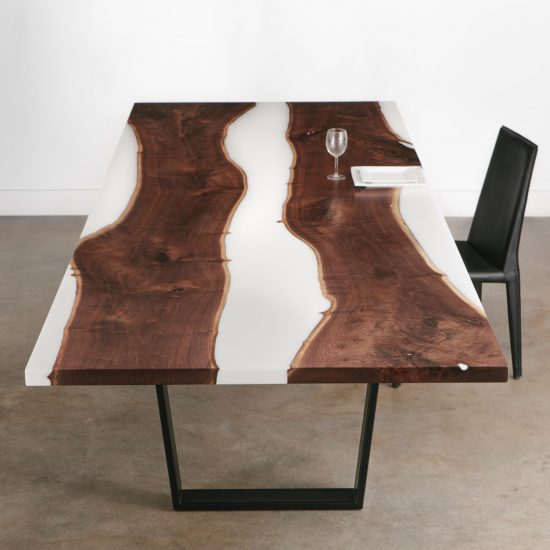 Modern live edge walnut dining room table with white resin